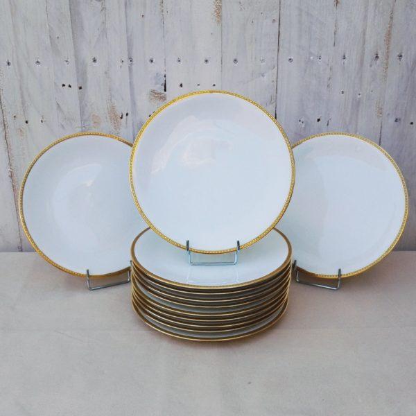 série douze assiettes plates en porcelaine fine de Limoges de l'ancienne fabrique royale
